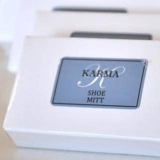 Karma shower cap, shoe mitt, mending kit and vanity pack are packaged in white board boxes with the Karma logo in the front.